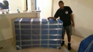 Image: Maya Van Lines mover readies an item for shipping - Maya Van Lines Moving Company, Atlanta GA