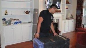 Image: Maya movers preparing a box - Maya Van Lines Moving Company, Atlanta GA